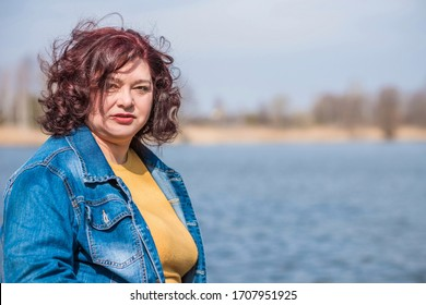 Sad Simple plump middle aged woman thinking about something, crisis of middle age and problems among overweight people