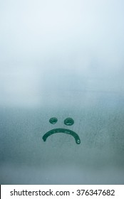 Sad smile inscription on the foggy glass background