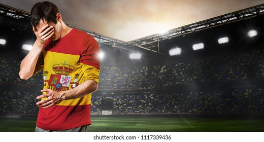 Sad Spain national team soccer or football player on stadium