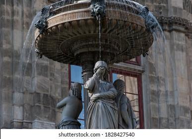 Sad statue in gothic fountain