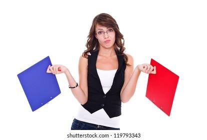 Sad student girl holding booklets