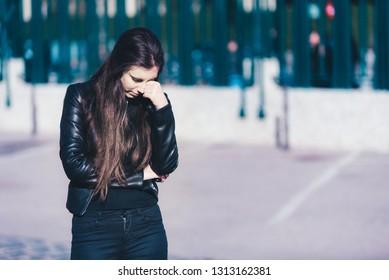 Sad teen girl millennial woman feeling heartbroken at phone, depressed upset by bad news in mobile feeling anxious.