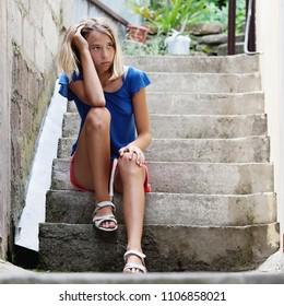 Sad teen girl outdoors. Unhappy teenager