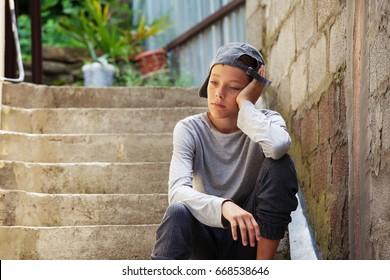 Sad teen outdoors. Unhappy teenager