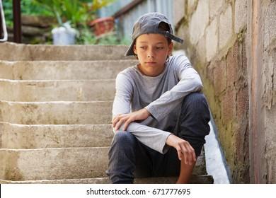 Sad teen outdoors. Unhappy teenager. Abuse