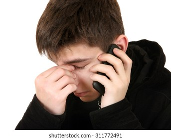 Sad Teenager with Cellphone Isolated on the White Background closeup