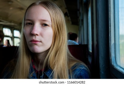 Sad teenager girl in train close-up portrait