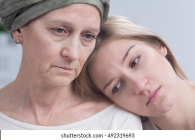 Sad terminally ill woman and her daughter