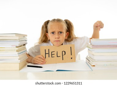 Sad tired and angry blonde school girl holding help sign in stress doing homework and studying with books in children education and low academic performance concept isolated on white background