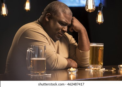 Sad and troubled guy at a bar