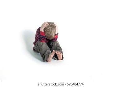 sad and unhappy child. Upset toddler boy. problem child with head in hands. concept for bullying, depression stress or frustration. Isolated on white background. Scared or terrified child.