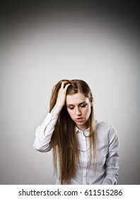 Sad and Unhappy woman in white.  Headache and problem concept.