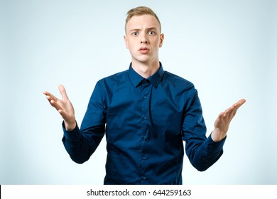 Sad upset young man over white background