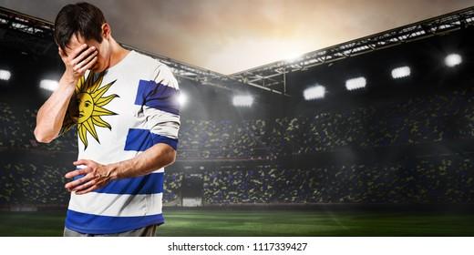 Sad Uruguay national team soccer or football player on stadium
