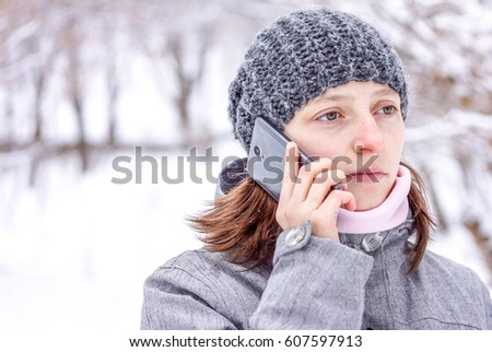 167bfeb3791027 sad white skin women with dark hair in grey knitted hat, light pink scarf  and