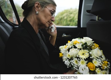 Sad widow on the way to the funeral