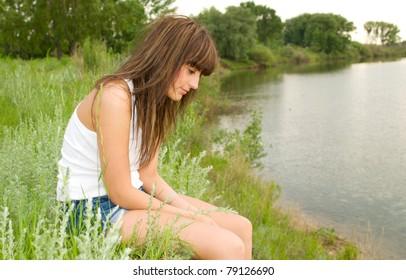 sad woman at the bank of river