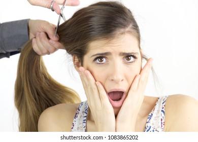 Sad woman at barbershop fear of loosing all hair