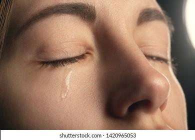 sad sad woman crying, closed eyes, closeup portrait