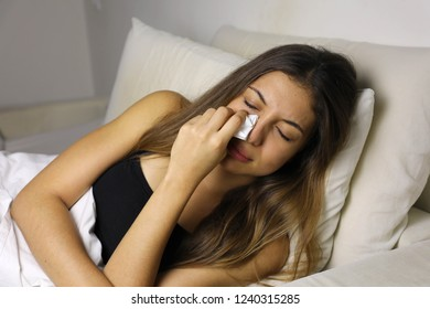 Sad woman crying on a bed at home in the night