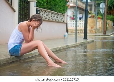 Sad woman crying on the street.