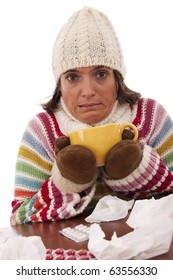 sad woman with flu symptom holding a mug with a hot drink (isolated on white)