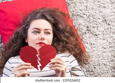 Sad woman hand hold broken heart. Relationship breakup or valentine day concept.