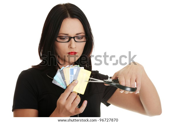 Sad woman has to destroy her credit card against a white background