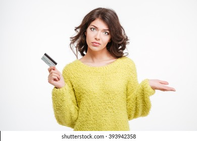 Sad woman holding bank card and copyspace on the palm isolated on a white background