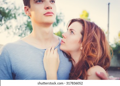 Sad woman hugging her boyfriend couple problems concept