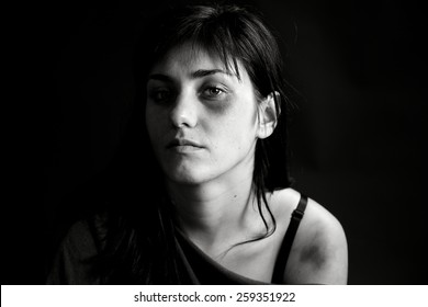 Sad woman looking in camera