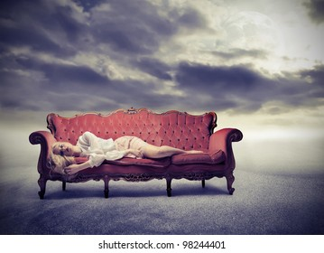 Sad woman lying on a sofa