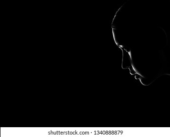 sad woman profile silhouette on black background with copy space, looking down, monochrome