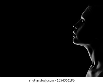 sad woman profile silhouette on black background with copy space closed eyes, monochrome