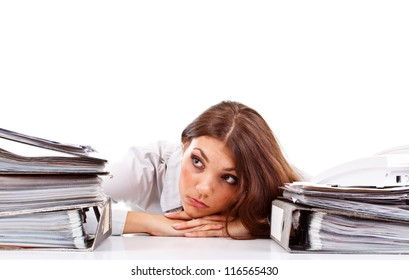 Sad woman with ringbinders sitting at the desk