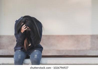 Sad woman sitting alone, Concept of sadness, melancholy