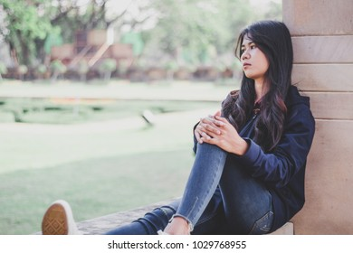 Sad woman sitting alone, Concept of sadness, melancholy