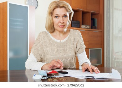 Sad woman thinking about the financial issue at  home