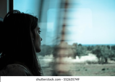 Sad woman traveling with train