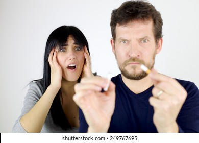 Sad woman unhappy about man destroying her cigarette
