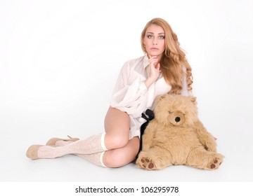 Sad woman is wondering and hug the plush teddy toy