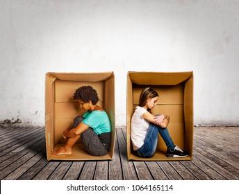 sad women inside a Box on a room