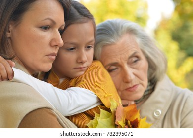 sad women with little girl