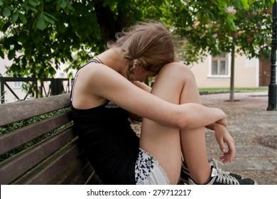 sad women on bench