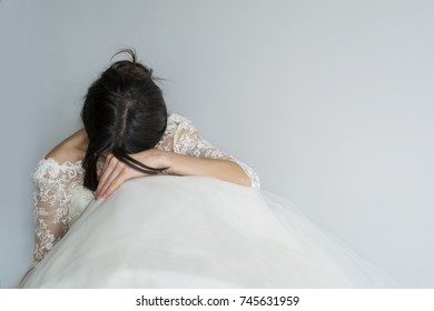 sad and worried bride crying in her wedding day