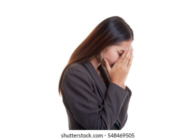 Sad young Asian businesswoman cry with palm to face  isolated on white background.