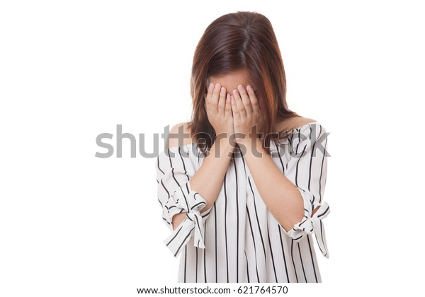 Sad young Asian woman cry with palm to face isolated on white background
