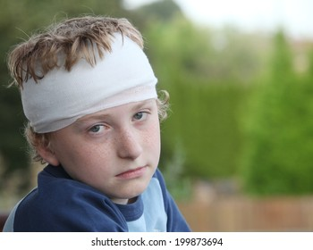 Sad young boy with bandage on his head