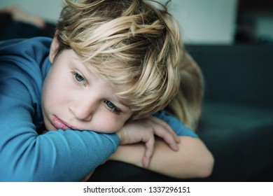 sad young boy, kids stress and exhaustion