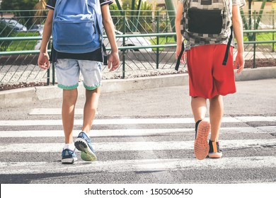 Sad young boys walking in the city, going to the college for the first day of school. Teenagers with backpack walks in urban contest. Back to secondary school. Education, lifestyle, youth, concept.